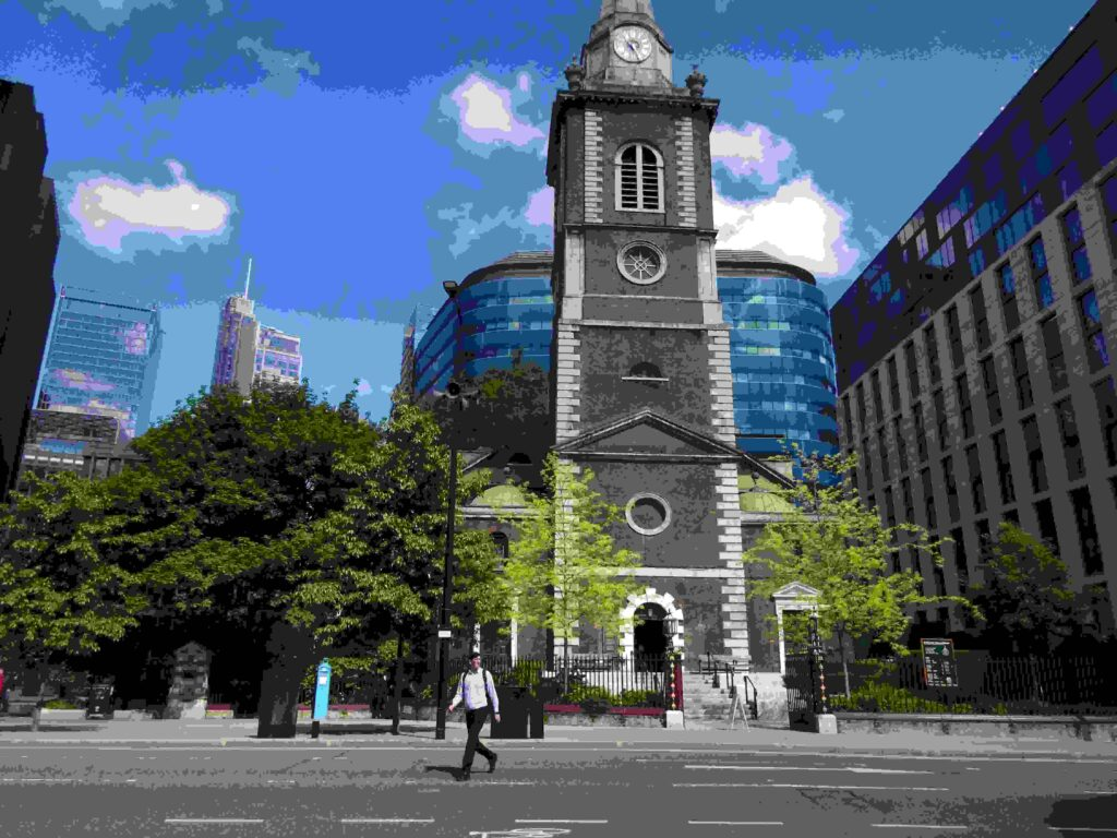 St Botolph without - with Aldgate and the Roman London wall to the left. In May 2021.