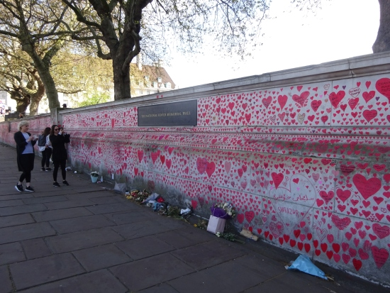 The covid memorial wall, and the plaque naming it, and the 150,000 hearts. Every one a name, every one a loved one.